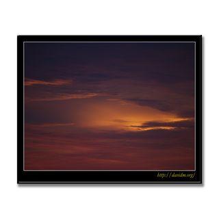 淡く光る夕陽の空