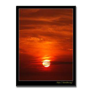 雲を燃やす絵鞆の夕陽