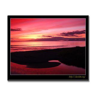 夕陽に染まる伊達の牛舎川の河口